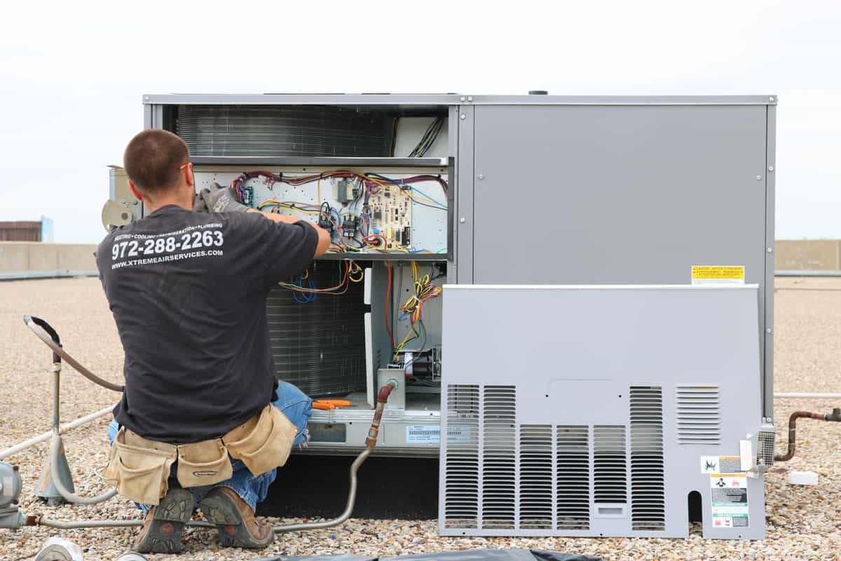 HVAC Technician performing air conditioner service
