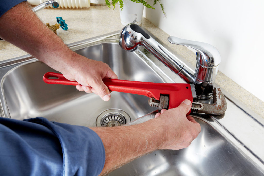Plumber installing a faucet in Forney, TX